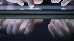 Female hands using modern application on tablet, typing message, zooming files Stock Footage