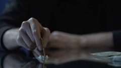 Close-up of male hand making lines of cocaine dose, drug addiction problem Stock Footage