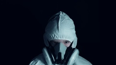 4k Creepy Shot of Child in Respirator Mask and Protective Suit Stock Footage