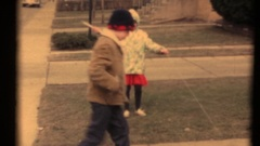 Vintage 8mm home movies, Siblings trying to fly a kite Stock Footage