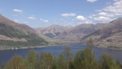 Pan: Five Sisters of Kintail and Loch Duich from the Mam Ratagan viewpoint Stock Footage