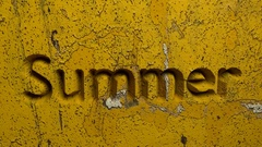 Summer word carved in a yellow stone wall animation Stock Footage