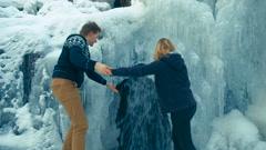 Winter waterfall. Fast stream water. Frozen water Stock Footage