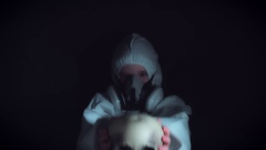 4k Creepy Shot of Child in Respirator Mask Holding a Skull Stock Footage