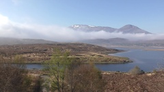 Right pan along Loch Achanalt in the Scottish Highlands Stock Footage