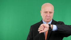 Businessman Looking Concerned to His Hand Watch Late for Business Meeting. Stock Footage