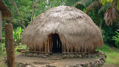 Traditional Indonesian Thatched Hut at Taman Nusa Park in Indonesia Stock Footage