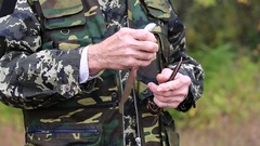 Man in military uniform with hunting knife Stock Footage