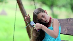 Beautiful girl combs his long hair Stock Footage