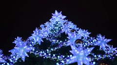 Christmas tree decorated with garlands and lanterns. Bottom view. Close-up Stock Footage