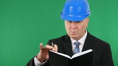 Serious Engineer Taking Daily Technical Notes in His Working Agenda. Stock Footage