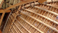 Interior details of a traditional, thatched roof in Indonesia. UltraHd 4k vid Stock Footage