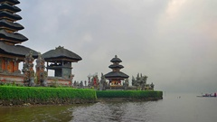 Local Hindus Approach Pura Ulun Danu Bratan Temple by Boat Stock Footage