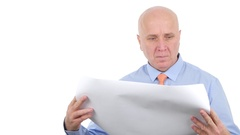 Businessman from Management Staff Analyzing One Building Paper Project. Stock Footage