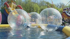 Large inflatable transparent water balls outdoors Stock Footage