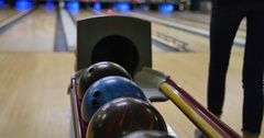 People Pickup Bowling Balls from Return at Alley Arkistovideo