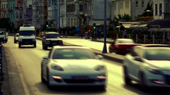 Approaching traffic of luxury cars on Sahil Street at Bebek. Retro look Stock Footage