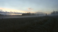 Timelapse of a sunset at a foggy field, on a cold day in late december, in .. Stock Footage