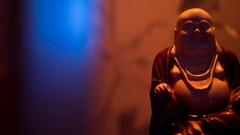 Ceramic figurine of fat bald Jolly Buddha Stock Footage