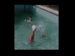 Neighborhood Kids splash and play in swimming pool Stock Footage