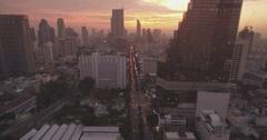 Orange Glow at Dusk Over City Skyline in Bangkok, Ascending Drone Shot Stock Footage