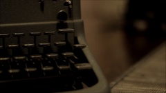 Old typewriter dark panning shot Stock Footage