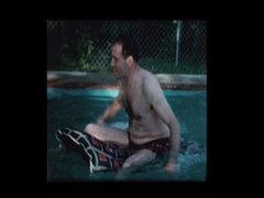 Man on raft in pool flips over Stock Footage