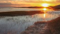 Sunset on the salted lake Durgun Nuur, Mongolia. Full HD Stock Footage