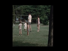 Families play badminton in backyard Stock Footage