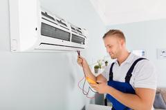 Electrician Checking Air Conditioner Stock Photos