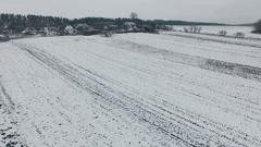 Aerial winter field near the village Stock Footage