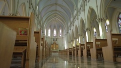 Cathedral Reveal Slider   Marbled checkered floor aisle under Gothic arches Stock Footage