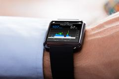 Person Wearing Smart Watch Showing Heartbeat Rate Stock Photos