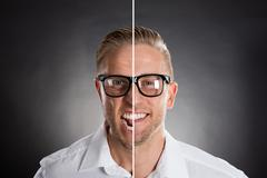 Man's Face Showing Anger And Happy Emotions Stock Photos