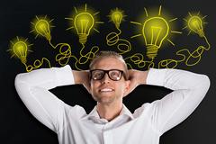 Young Man Looking Up With Creative Light Bulb Sketches Stock Photos