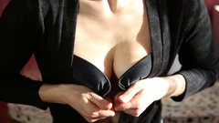 Young sexy woman in a short black skirt buttons bra Stock Footage