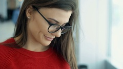Attractive young woman looking a smart phone or tablet. close-up Stock Footage