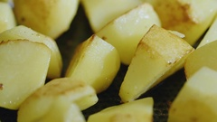 Lightly fried potatoes mixed in a pan. Tasty, but not healthy food Stock Footage