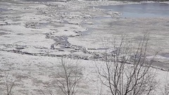 River spring ice breakup ice jams is ice walking on ice is dangerous Stock Footage