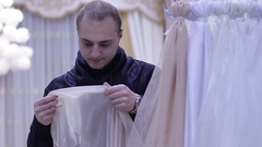 Man choosing curtains in shop. Stock Footage