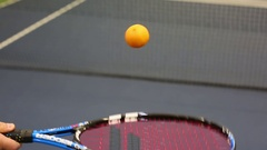 Tennis racket play tangerine Stock Footage