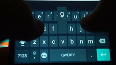 Hands of man typing text using smartphone Stock Footage