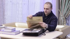 Man looks catalog of textile fabrics in the store Stock Footage
