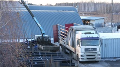 Finished goods warehouse on the street in winter loading with a crane Stock Footage