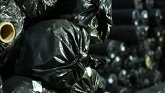 Finished product storage pipe rolls of plastic bags Stock Footage
