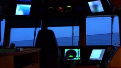 Sea view from bridge of ship rocking. Evening after sunset Stock Footage