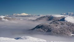 Snowy Mountains and Clouds Timelapse Stock Footage