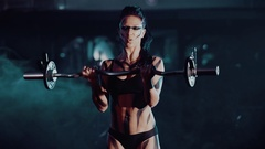 Young muscular girl doing pull up exercise on horizontal bar in gym Stock Footage