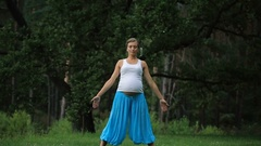 Pregnant yoga prenatal maternity doing different exercises. in the park on the Stock Footage