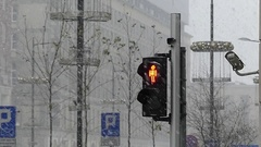A Retro Traffic Light in Snowy Weather. Stock Footage